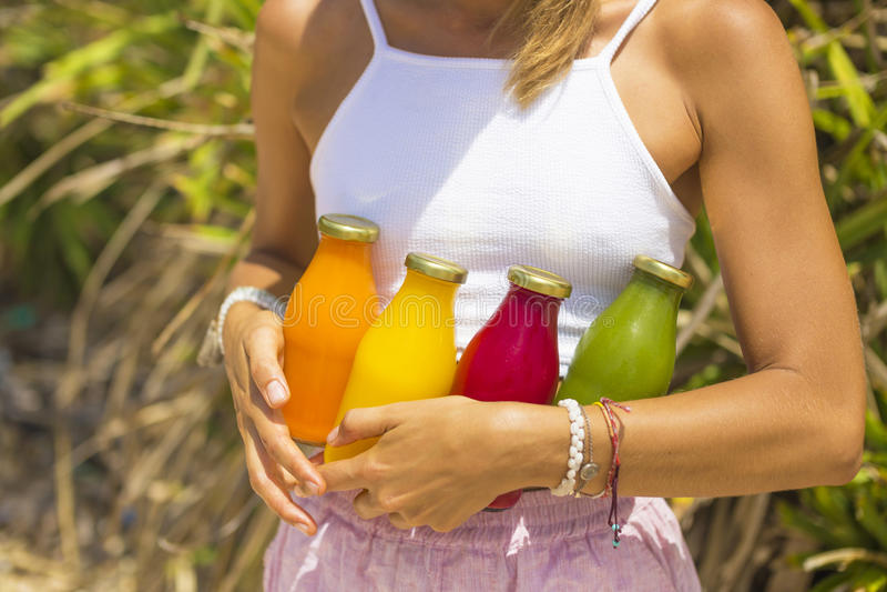 Organic cold-pressed raw vegetable juice stock photos