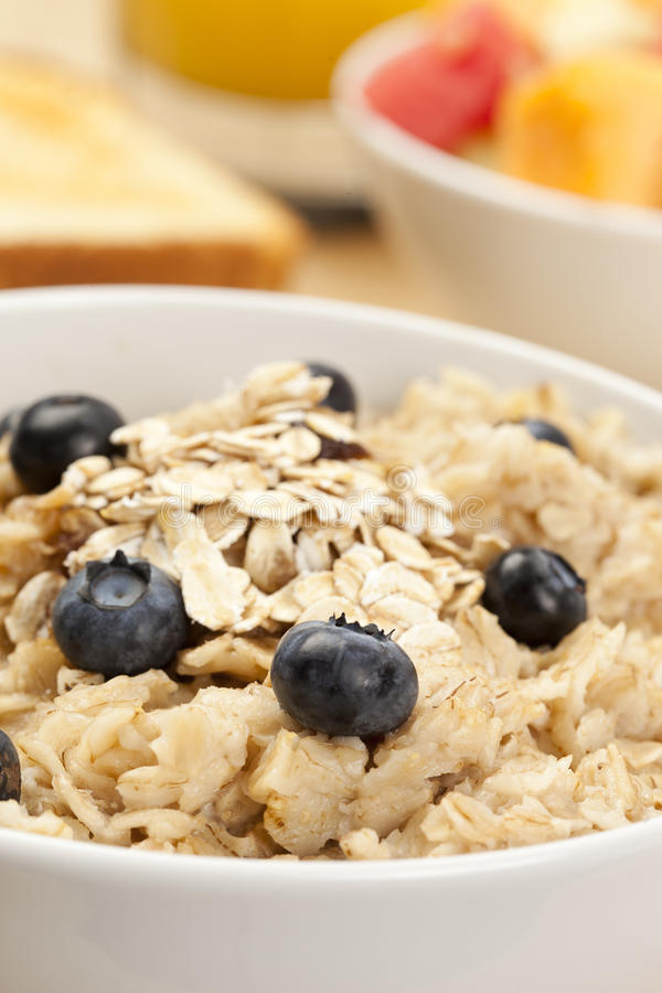 Organic Cooked oatmeal with blueberries stock photography