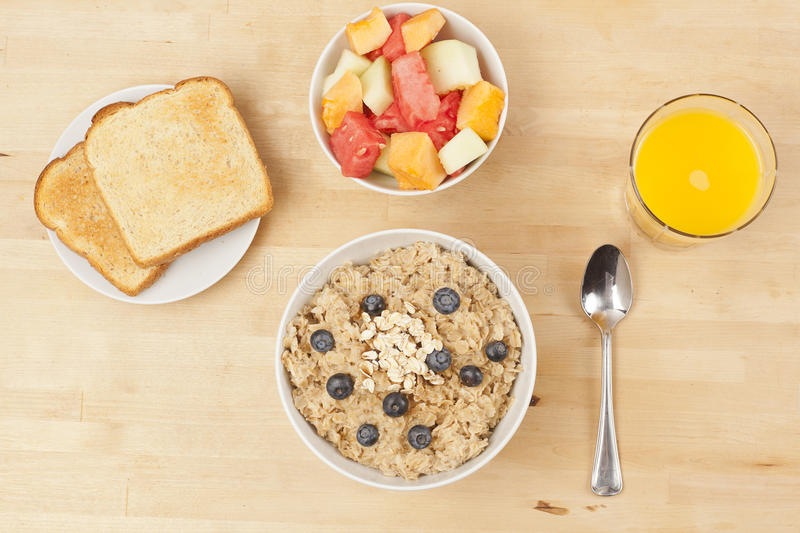 Organic Cooked oatmeal with blueberries royalty free stock images