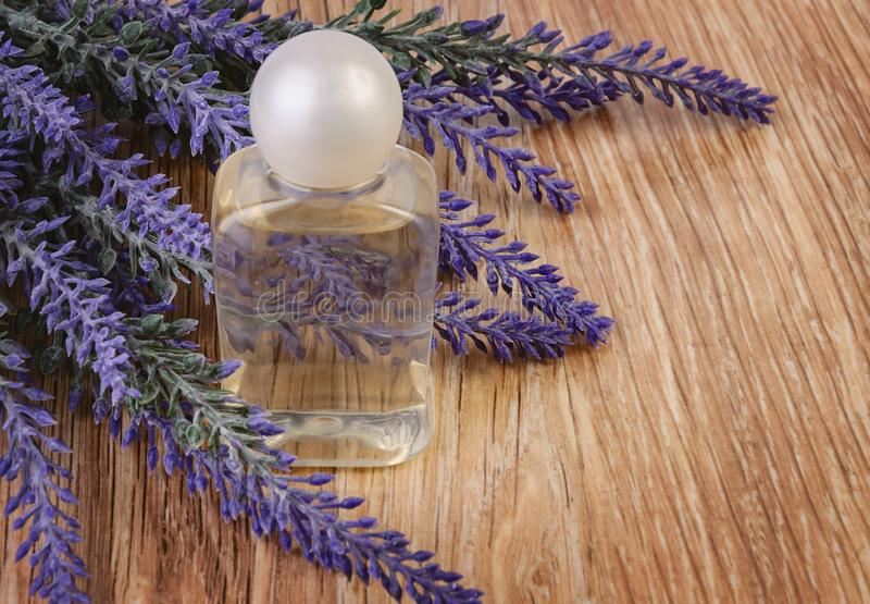 Organic cosmetic in bottle and lavender flowers on wooden royalty free stock photo