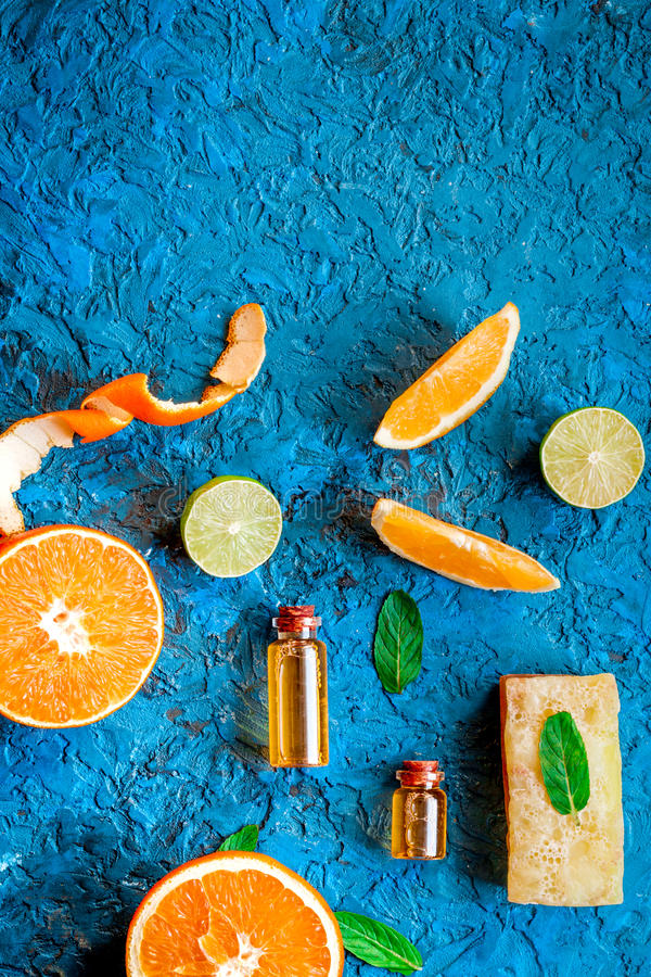 Organic cosmetic with citrus on blue background top view.  royalty free stock image