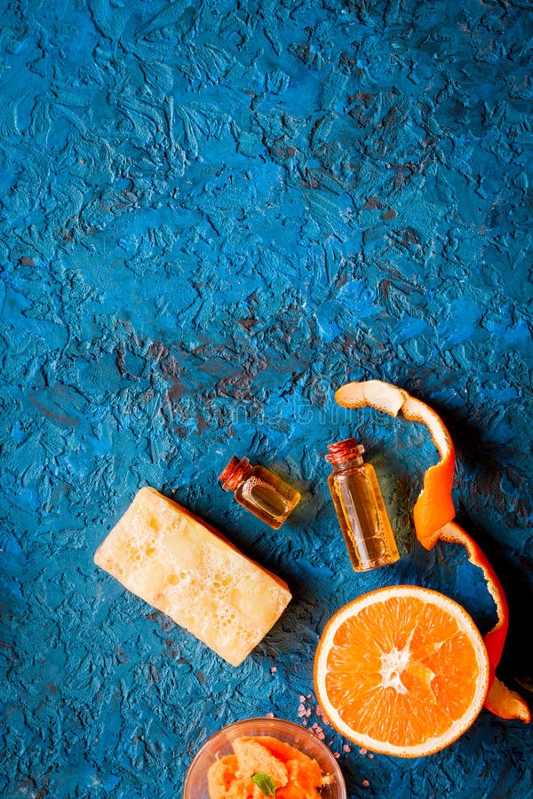 Organic cosmetic with citrus on blue background top view.  stock photos
