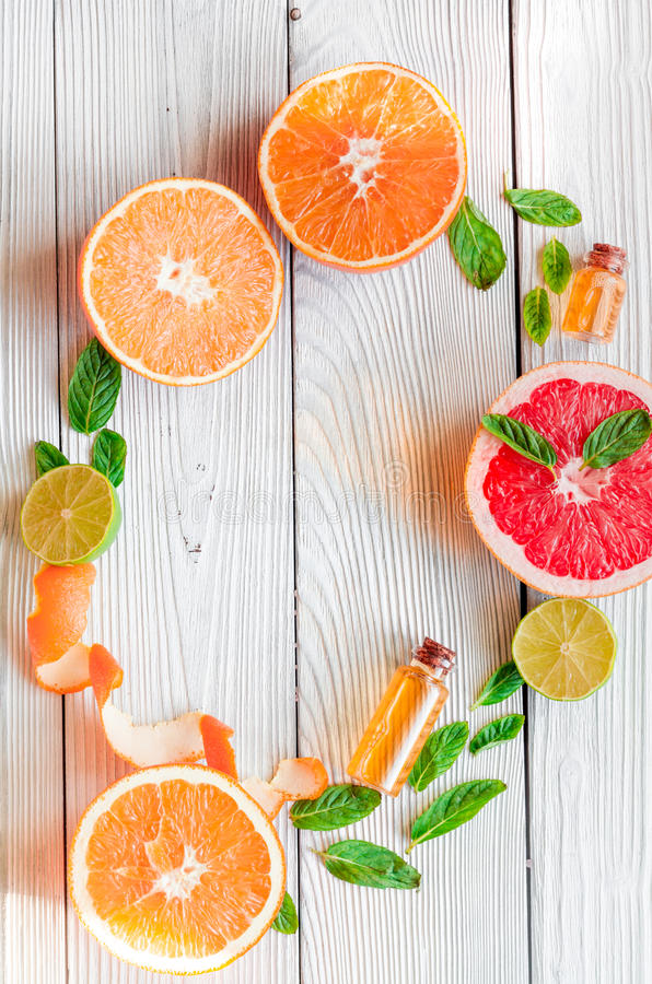 Organic cosmetic with citrus on wooden background top view.  royalty free stock image