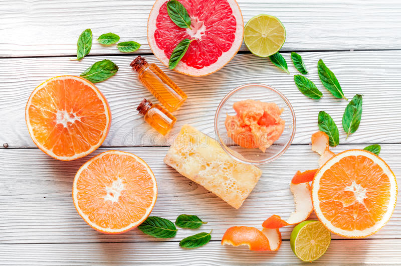 Organic cosmetic with citrus on wooden background top view.  stock photo