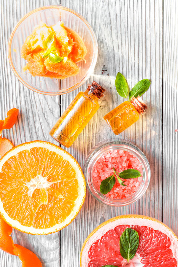 Organic cosmetic with citrus on wooden background top view.  royalty free stock photo