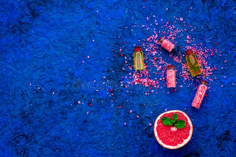 Organic cosmetic with grapefruit for homemade spa with salt and fresh fruit on blue background top view mock-up stock photography