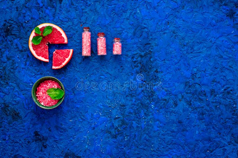 Organic cosmetic with grapefruit for homemade spa with salt and fresh fruit on blue background top view mock-up stock photos