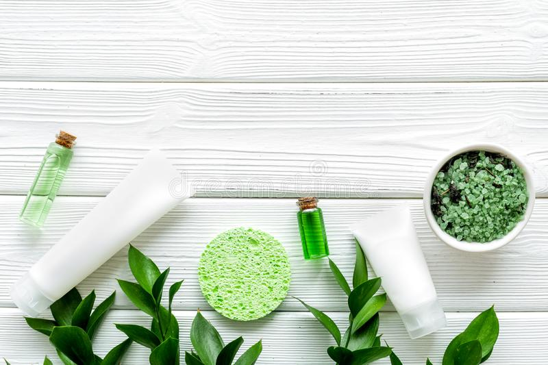 Organic cosmetic with herbs on white wooden background top view mock up royalty free stock photos
