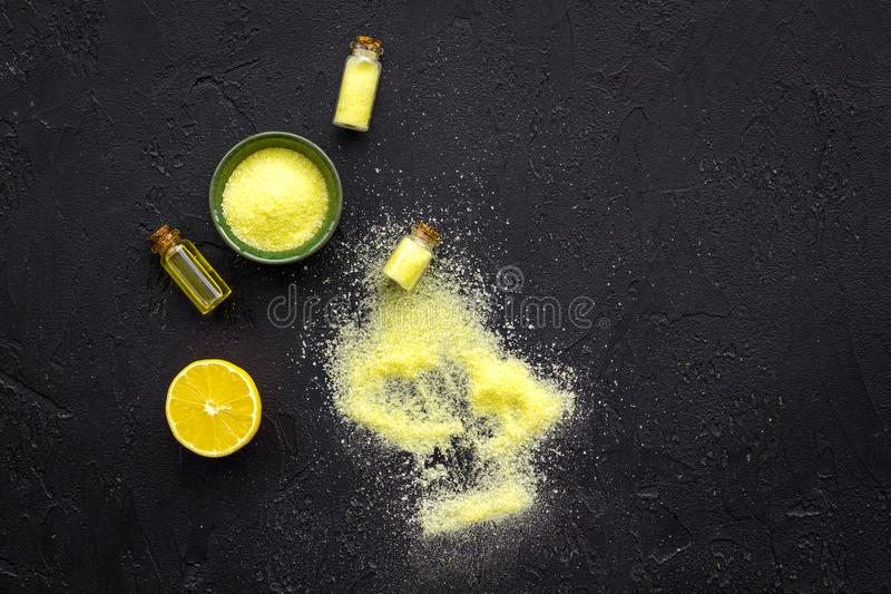 Organic cosmetic with lemon for homemade spa with oil and fresh fruit black background top view mock up stock photos