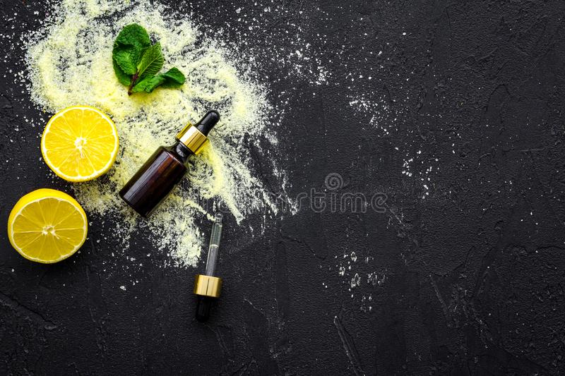 Organic cosmetic with lemon for homemade spa with oil and fresh fruit black background top view mock up stock images