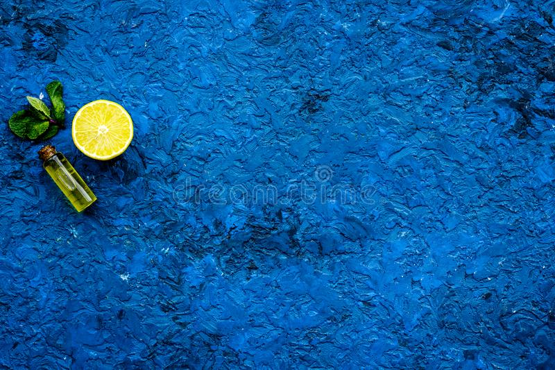 Organic cosmetic with lemon for homemade spa with oil and fresh fruit blue background top view mock up royalty free stock images