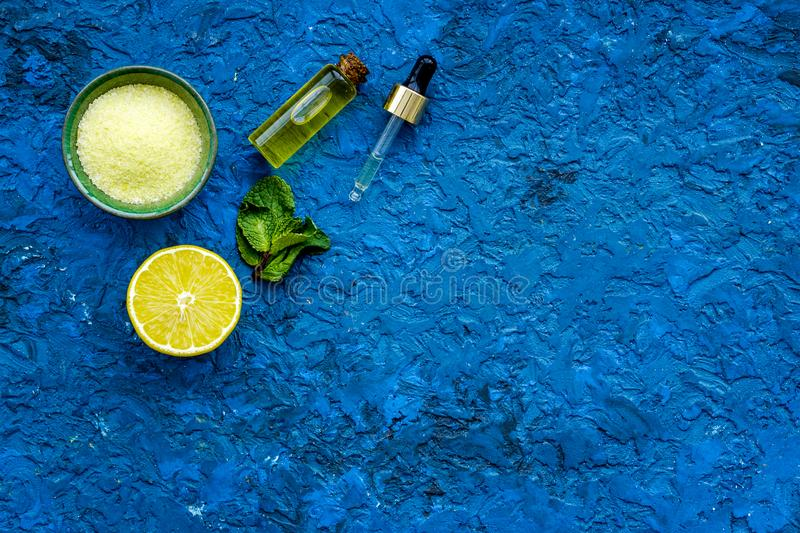 Organic cosmetic with lemon for homemade spa with oil and fresh fruit blue background top view mock up stock images