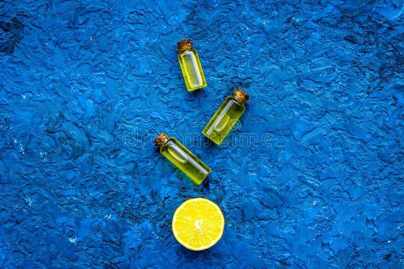 Organic cosmetic with lemon for homemade spa with oil and fresh fruit blue background top view mock up stock photography
