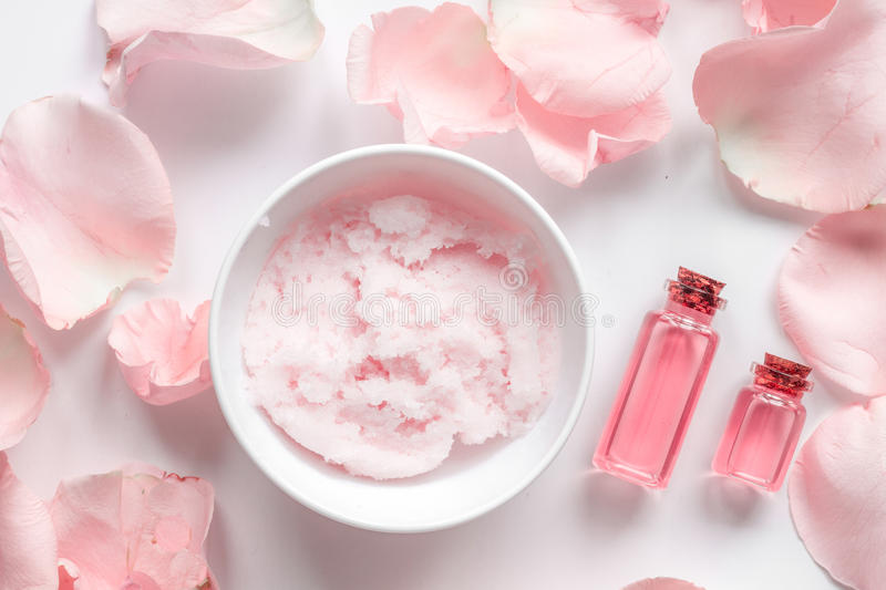 Organic cosmetic with rose oil on white background top view.  royalty free stock photo