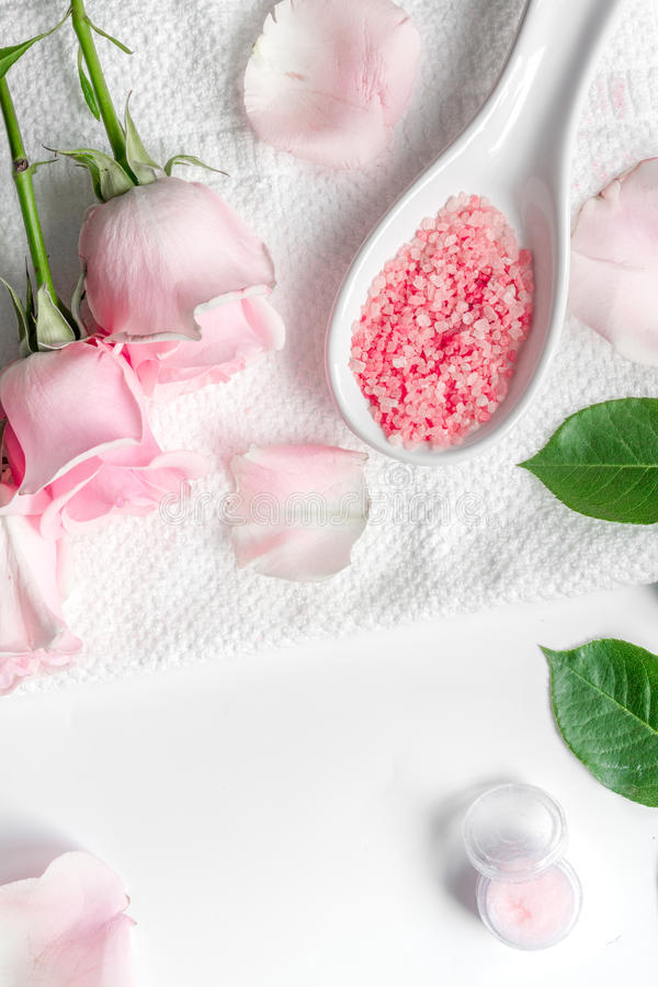Organic cosmetic with rose oil on white background top view.  royalty free stock photography