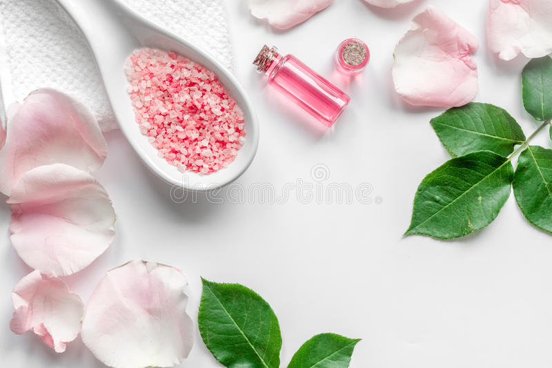 Organic cosmetic with rose oil on white background top view.  stock images