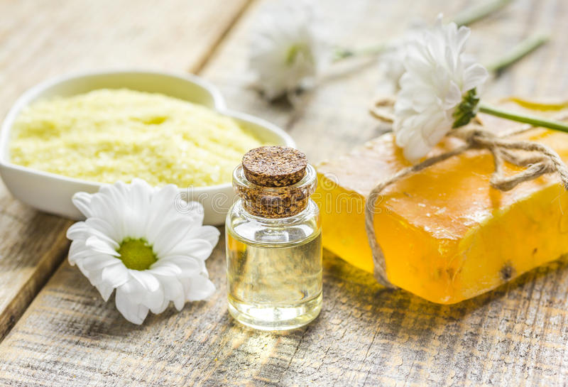 Organic cosmetics with camomile extract on wooden table background. Organic homemade cosmetics with camomile extract on wooden table background royalty free stock photos