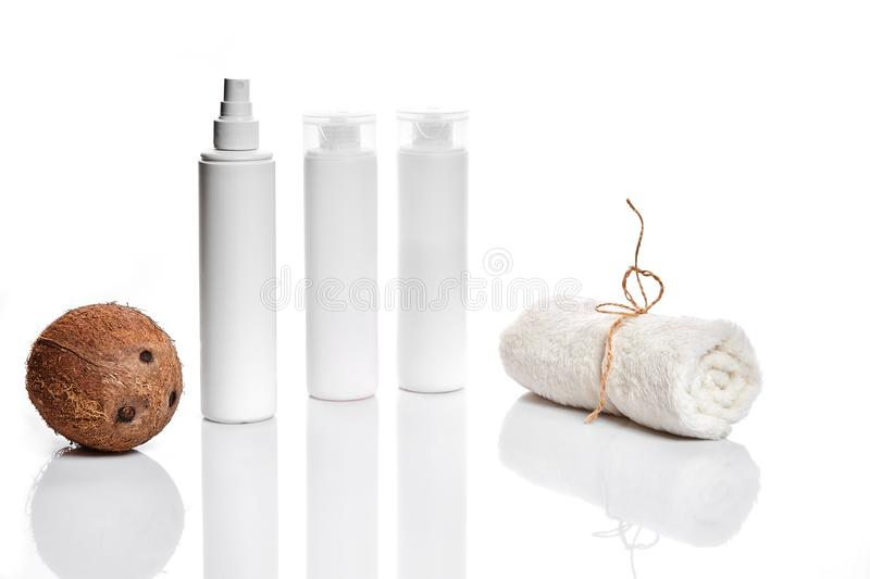Organic cosmetics with coconut on white background. royalty free stock image