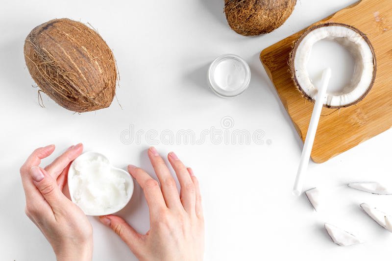 Organic cosmetics with coconut on white background top view.  royalty free stock image