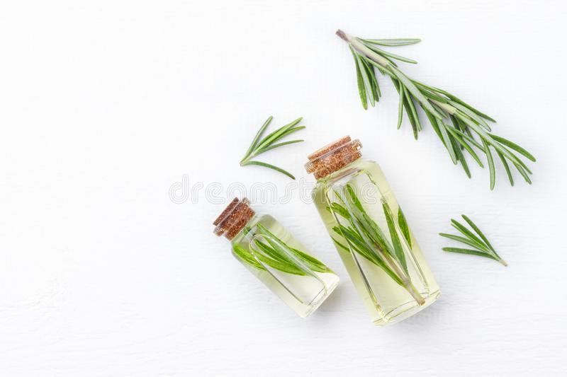 Organic cosmetics with extracts of herbs rosemary on white royalty free stock photo