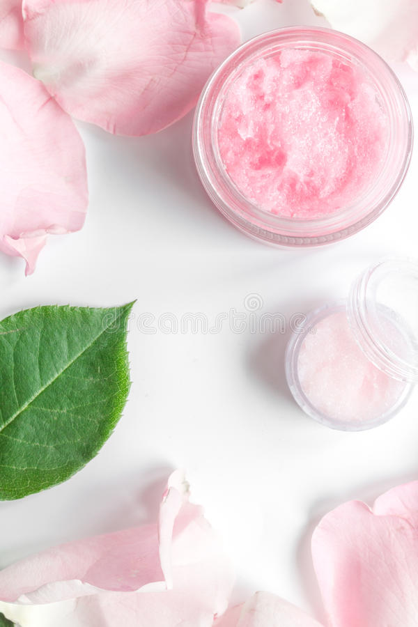Organic cream with rose oil on white background top view.  royalty free stock images