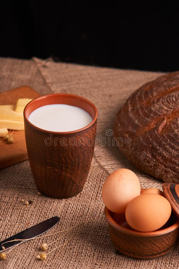 organic dairy products - milk, cheese, and also eggs, bread. on table royalty free stock photos