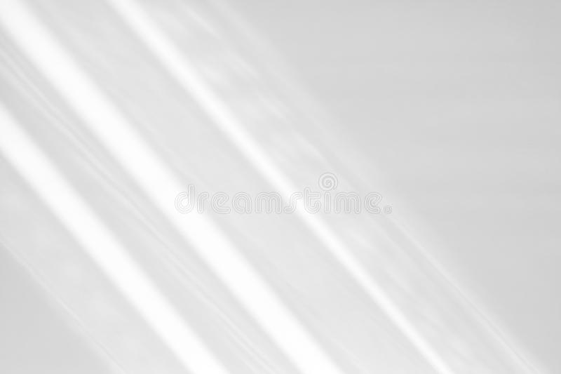 Organic drop shadow on a white wall. Organic drop diagonal shadow on a white wall, overlay effect for photo, mock-ups, posters, stationary, wall art, design royalty free stock photos