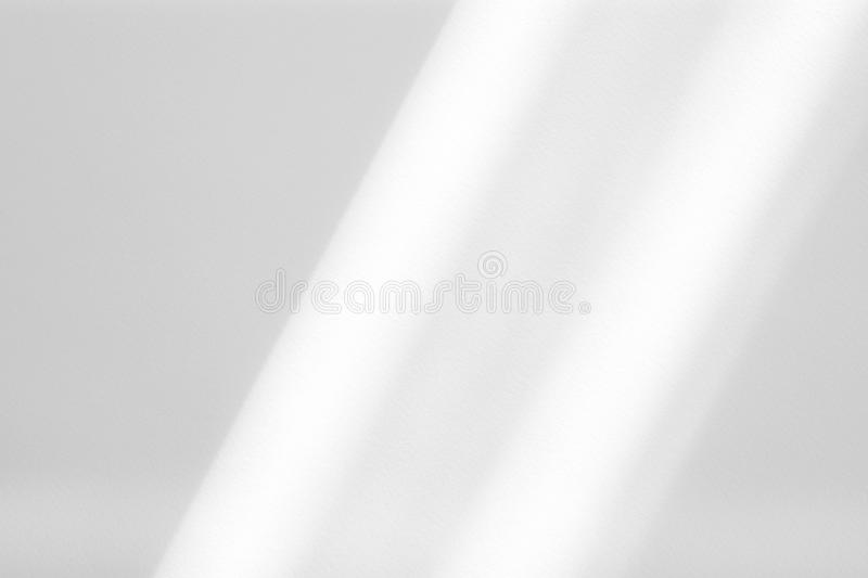 Organic drop shadow on a white wall. Organic drop diagonal shadow on a white wall, overlay effect for photo, mock-ups, posters, stationary, wall art, design royalty free stock images