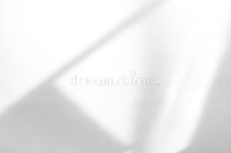 Organic drop shadow on a white wall. Organic drop diagonal shadow on a white wall, overlay effect for photo, mock-ups, posters, stationary, wall art, design stock image