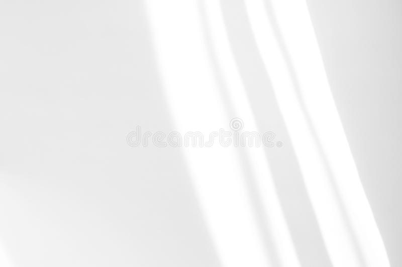 Organic drop shadow on a white wall. Organic drop diagonal shadow on a white wall, overlay effect for photo, mock-ups, posters, stationary, wall art, design royalty free stock photo