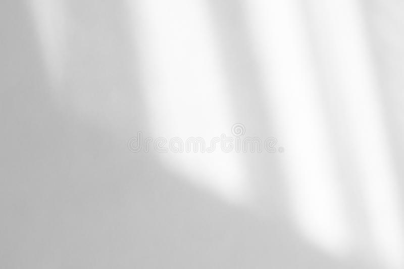 Organic drop shadow on a white wall. Organic drop diagonal shadow on a white wall, overlay effect for photo, mock-ups, posters, stationary, wall art, design royalty free stock photography