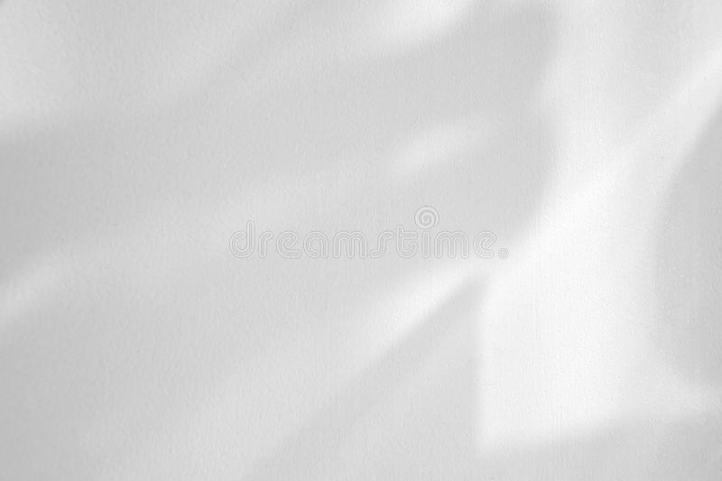 Organic drop shadow on a white wall. Organic drop diagonal shadow on a white wall, overlay effect for photo, mock-ups, posters, stationary, wall art, design stock photos