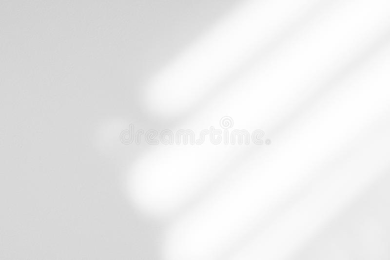 ЮOrganic drop shadow on a white wall. Organic drop diagonal shadow on a white wall, overlay effect for photo, mock-ups, posters, stationary, wall art, design stock images