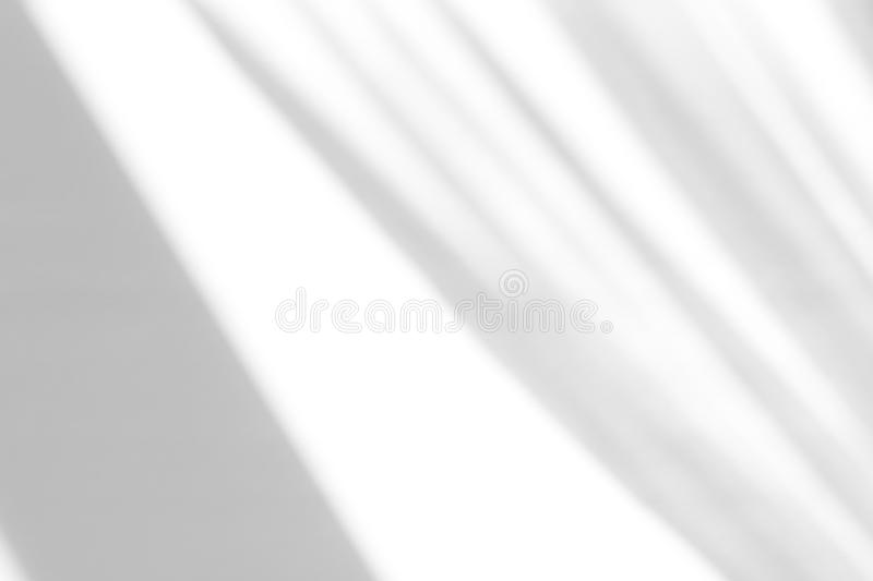 Organic drop shadow on a white wall. Organic drop diagonal shadow on a white wall, overlay effect for photo, mock-ups, posters, stationary, wall art, design stock images