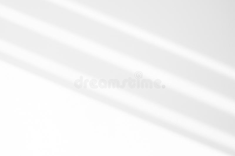 Organic drop shadow on a white wall. Organic drop diagonal shadow on a white wall. Overlay effect for photo, mock-ups, posters, stationary, wall art, design royalty free stock photos
