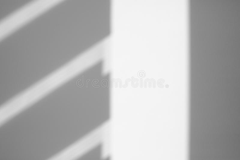 Organic drop shadow on a white wall stock images