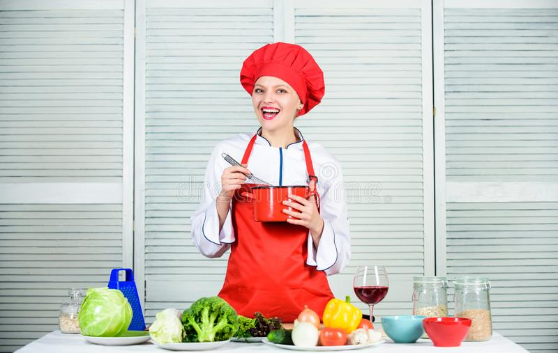 Organic eating and vegetarian. Housewife. happy woman cooking healthy food by recipe. professional chef in kitchen. Restaurant menu. Dieting. woman in cook hat stock photography