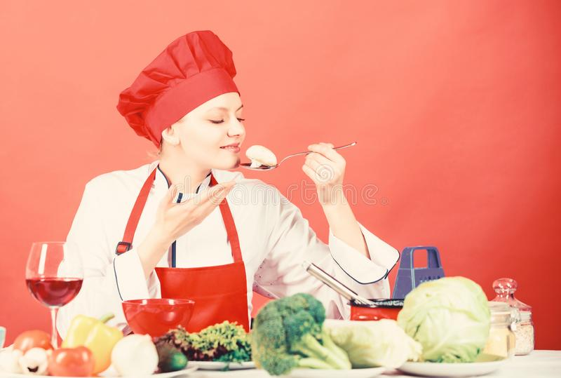 Organic eating and vegetarian. Housewife. happy woman cooking healthy food by recipe. restaurant menu. Dieting. Professional chef on red background. woman in royalty free stock photo