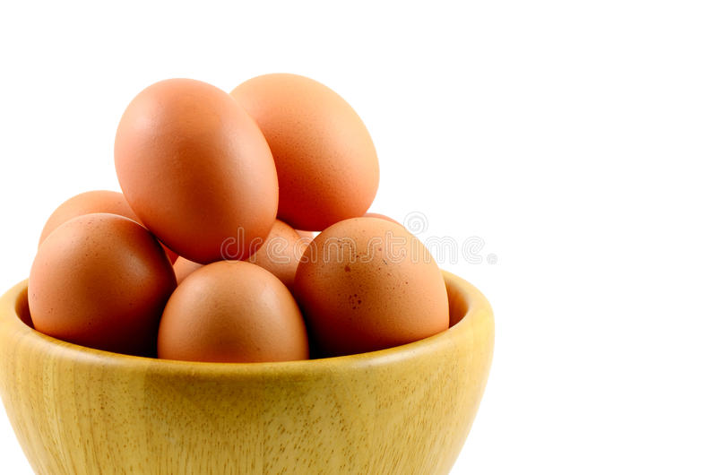 Organic Eggs. Organic eggs in wooden bowl royalty free stock images
