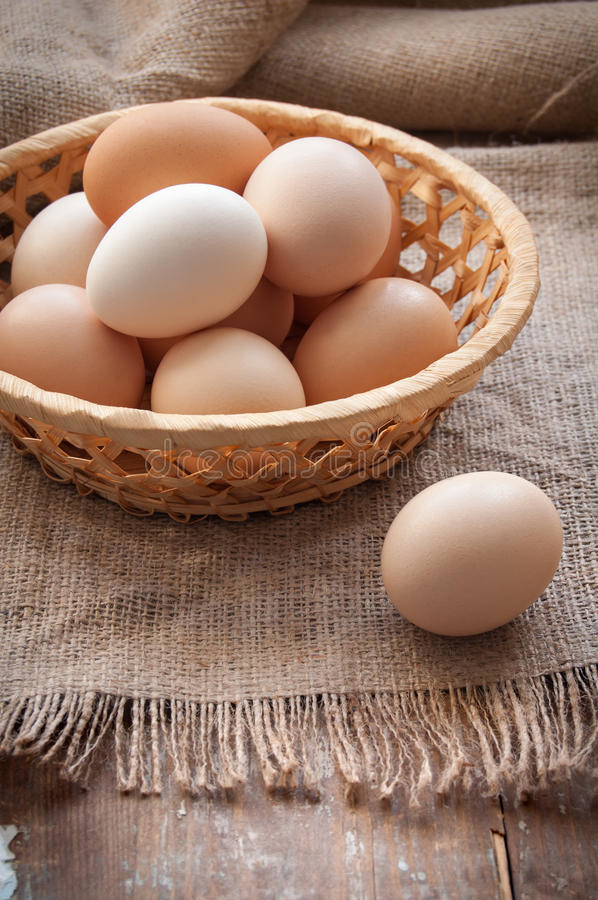 Organic eggs. In the basket on the cloth stock photography