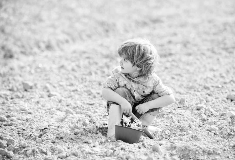 Organic farm. planet protection. small kid planting flower. ecology life. eco farm. human nature. earth day. summer farm. Happy child gardener. plant nursery stock photos