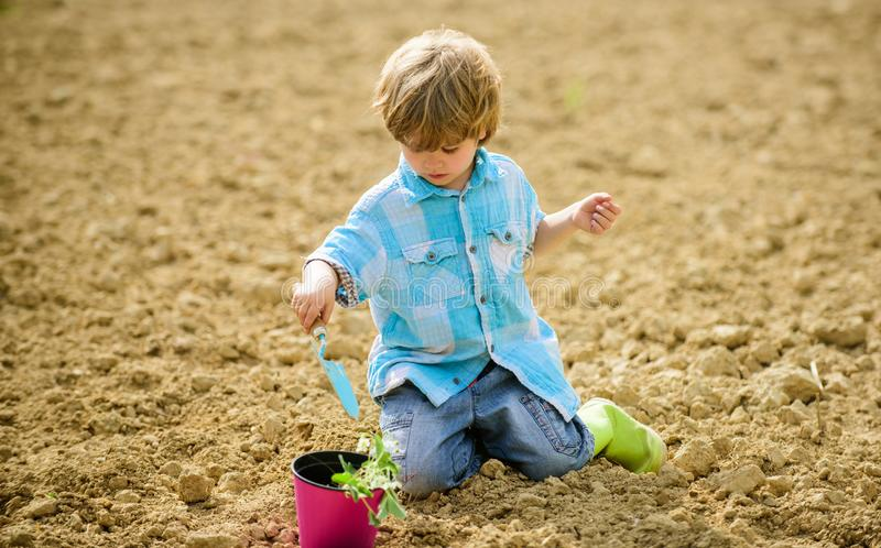 Organic farm plantation. ecology life. eco farm. human and nature. earth day. Eco life. summer farm. happy child seeding. On rich soil. Spring season. small kid stock images