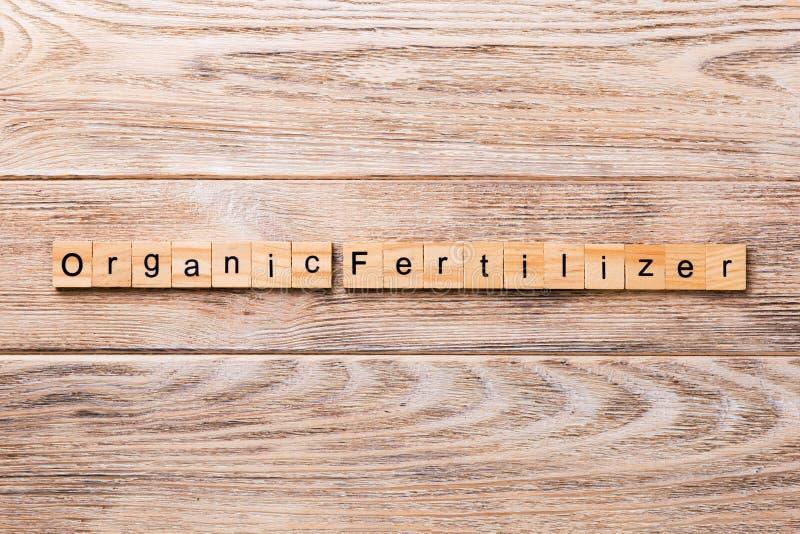Organic fertilizer word written on wood block. organic fertilizer text on wooden table for your desing, concept stock photos