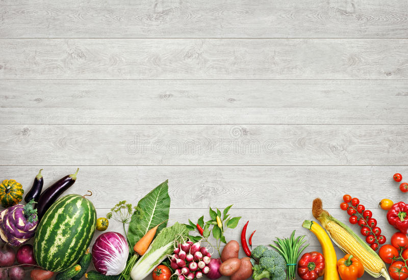 Organic food background. Studio photo of different fruits and vegetables. On white wooden table. High resolution product