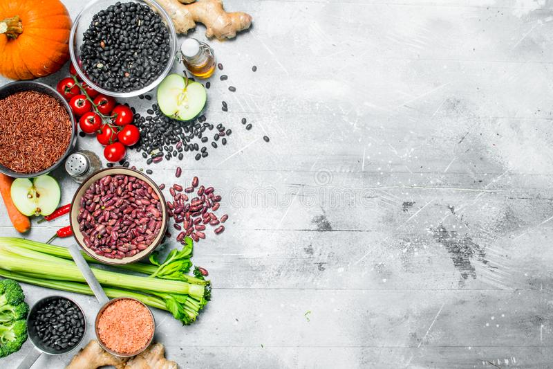 Organic food. Healthy assortment of vegetables and fruits with legumes royalty free stock images