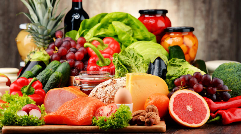 Organic food including vegetables, fruit, bread, dairy and meat stock photography