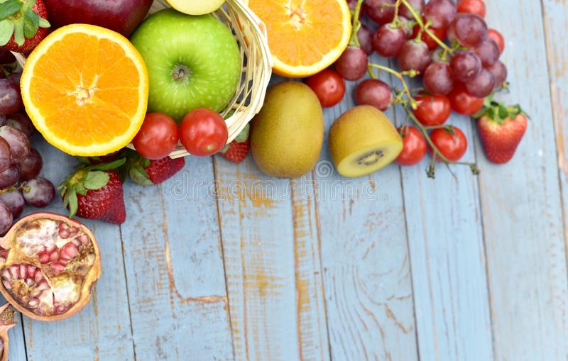 Organic fruits on wooden table stock photos