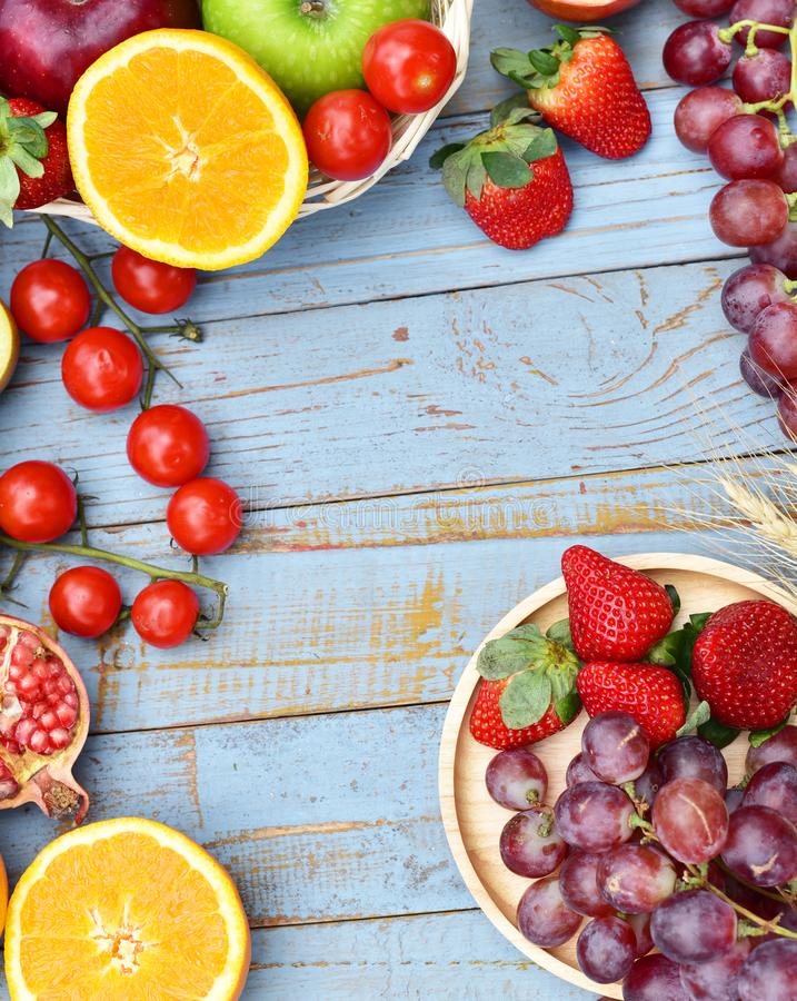 Organic fruits on wooden table stock photography