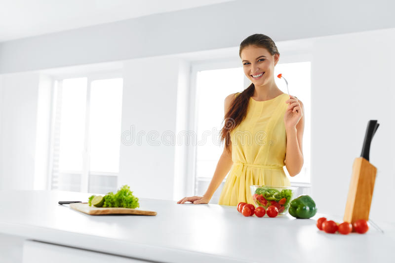 Organic Food. Woman Eating Vegetable Salad. Healthy Lifestyle, D. Organic Food. Portrait Of Young Smiling Woman Eating Fresh Healthy Vegetable Salad In Modern royalty free stock photography