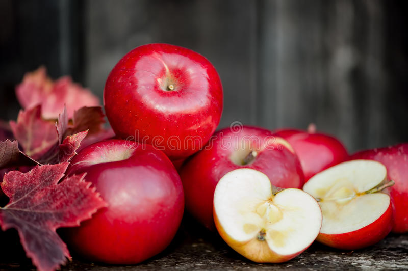 Organic fresh apples on wooden background in autum. N harvest at local farm. Agriculture concept theme with fresh apples in nature stock photo